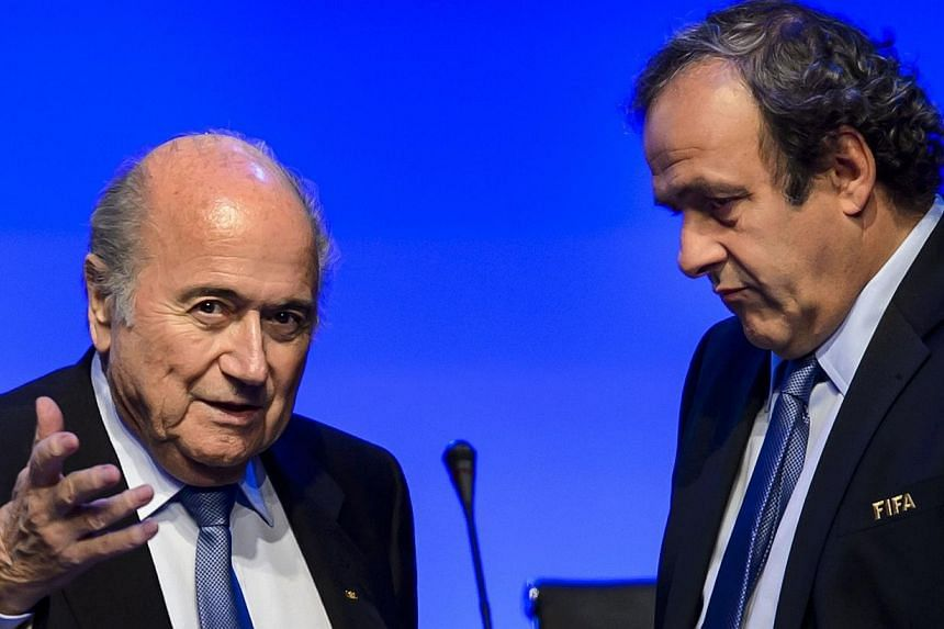 Fifa president Sepp Blatter (left) talks to Uefa president Michel Platini during the 64th Fifa congress on June 11, 2014 in Sao Paulo, on the eve of the opening match of the 2014 Fifa World Cup in Brazil. Platini will not stand for election as presid