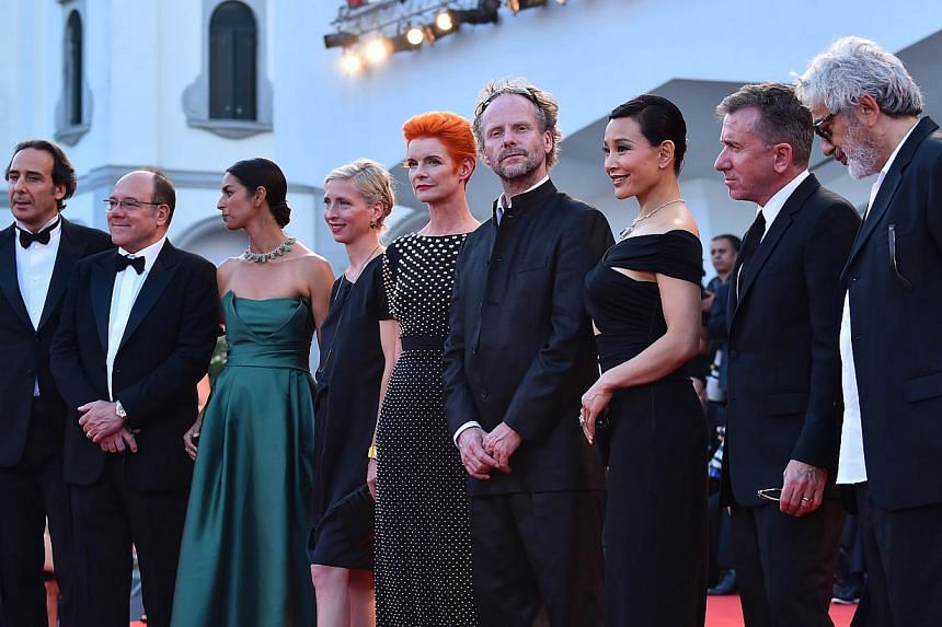Members of the jury (from left) French composer and president Alexandre Desplat, Italian actor Carlo Verdone, US author Jhumpa Lahiri, Austrian director Jessica Hausner, British costume designer Sandy Powell, German director Philip Groning, Chinese a