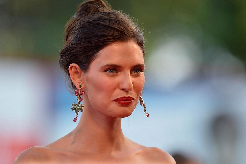 Model Bianca Balti arrives for the screening of the movie Birdman or the Unexpected Virtue of Ignorance presented in competition for the opening ceremony of the 71st Venice Film Festival on Aug 27, 2014 at Venice Lido. -- PHOTO: AFP