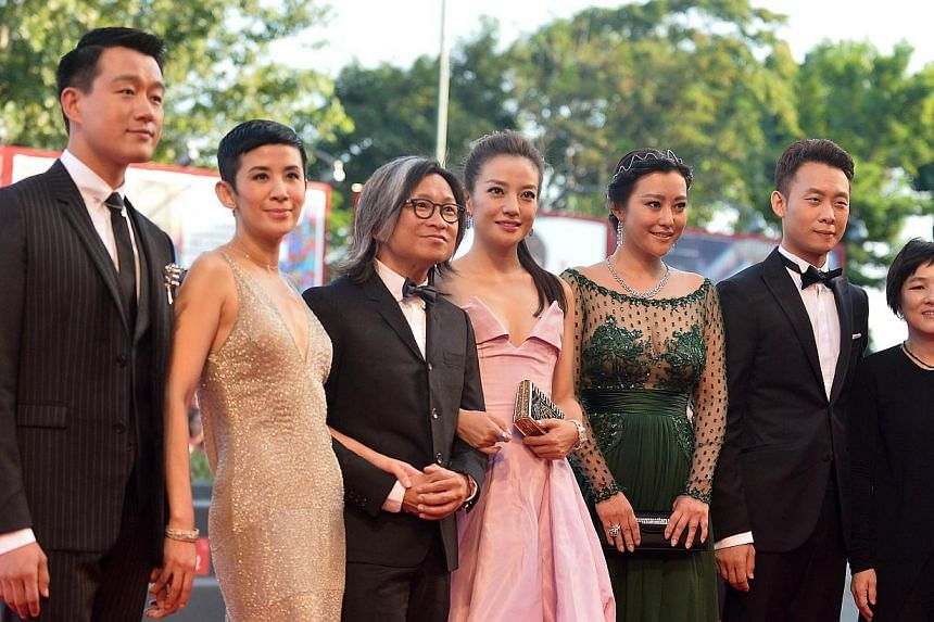 (From left) Actors Tong Dawei, Sandra Ng, director Peter Chan, actresses Zhao Wei, Lei Hao, Zhang Yi and another guest arrive for the screening of the movie Birdman or the Unexpected Virtue Of Ignorance presented in competition at the opening ceremon