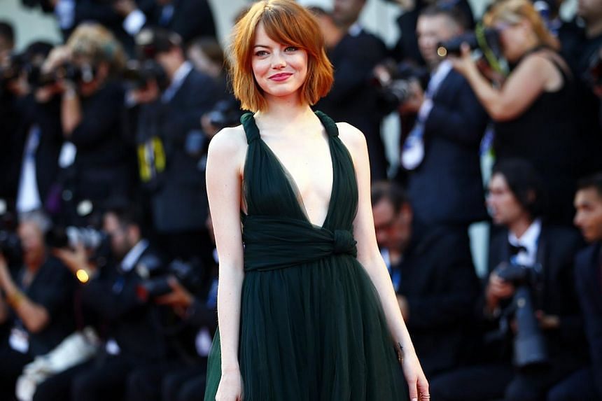 US actress Emma Stone poses during the red carpet for the movie Birdman or the Unexpected Virtue of Ignorance at the 71st Venice Film Festival on Aug 27, 2014. -- PHOTO: REUTERS