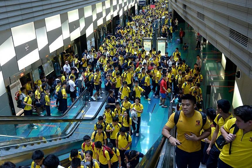 ACS (I) students get off the train at Stadium station on the Circle Line. Transport operator SMRT's decision to allow Anglo-Chinese School (Independent) to charter five MRT trains to ferry some 3,000 students to a rugby match has sparked a debat