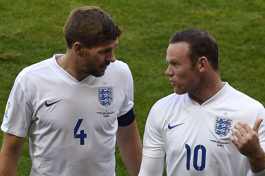 Manchester United striker Wayne Rooney (right) will succeed outgoing skipper Steven Gerrard (left) as England captain. -- PHOTO: AFP