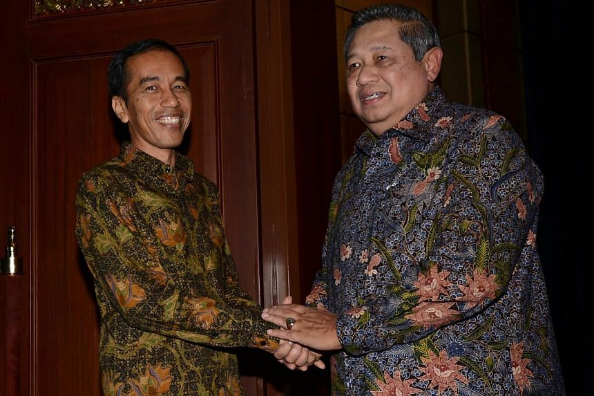 Outgoing Indonesian President Susilo Bambang Yudhoyono (right) meets president-elect Joko Widodo (left) in Nusa Dua, on Indonesia's resort island of Bali on Aug 27, 2014, to discuss a smooth government transition programme.Indonesian President-