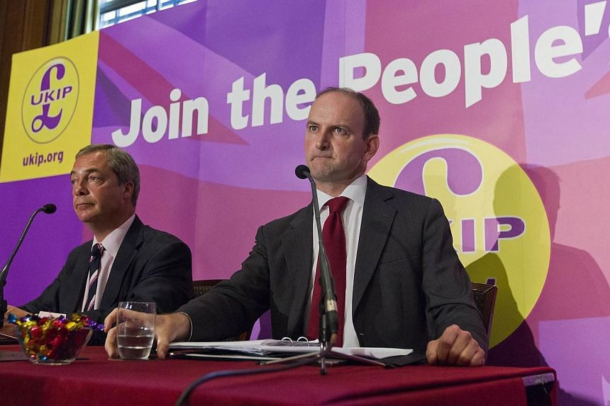 Former British Conservative Party MP Douglas Carswell (right) addresses a press conference in central London on Aug 28, 2014, with UKIP Party leader Nigel Farage (left).-- PHOTO: AFP