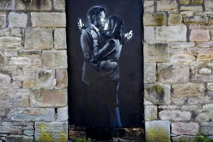 A work by the British street artist Banksy has saved a struggling youth club from closure after it was sold to a collector for £403,000 (S$889,016). -- PHOTO: TWITTER