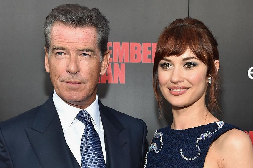 Co-stars Pierce Brosnan and Olga Kurylenko (both above) at the premiere of November Man (left), which Brosnan produced and acted in.