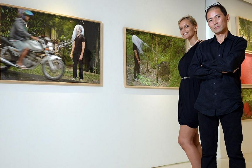 Artist Jason Lim and curator of the show Daniela Beltrani with works from the exhibition. -- ST PHOTO: DESMOND WEE