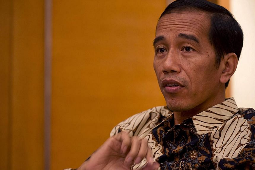 Mr Joko (above) has been manoeuvring to restructure the political landscape by winning over members of Mr Prabowo's coalition.