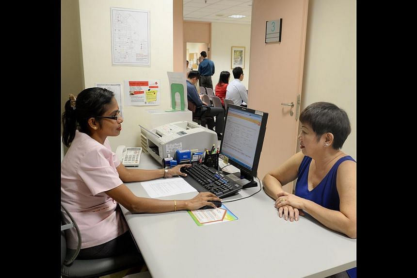 A patient making an appointment at Outram Polyclinic. Since SingHealth began allowing staff at its nine polyclinics to directly book appointments, internal appointment phone traffic has dropped by about 60 per cent.
