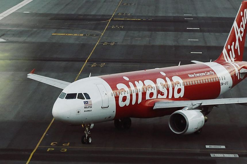 An AirAsia plane is seen on the runway at Kuala Lumpur International Airport on 19, 2014. -- PHOTO: REUTERS