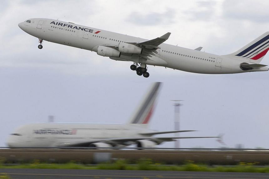 This file picture dated on Aug 18, 2014 shows An Air France Airbus 340 aircraft taking off at the Roissy-Charles-de-Gaulle airport, in Roissy-en-France. -- PHOTO: AFP