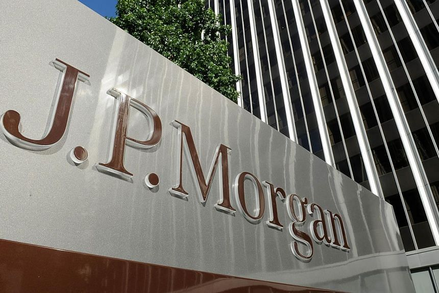 This Aug 8, 2013 file photo shows a JPMorgan sign outside the office tower housing the financial services firm's Los Angeles, California offices. -- PHOTO: AFP