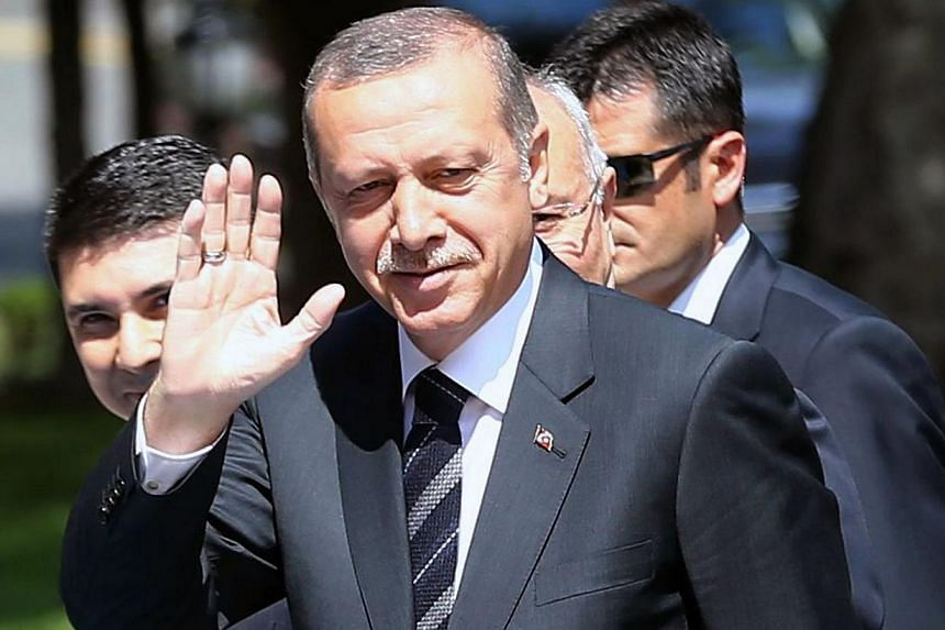 Turkey's outgoing Prime Minister Recep Tayyip Erdogan is to be sworn in as president on Thursday to extend his more than decade-long domination of the country. -- PHOTO: AFP