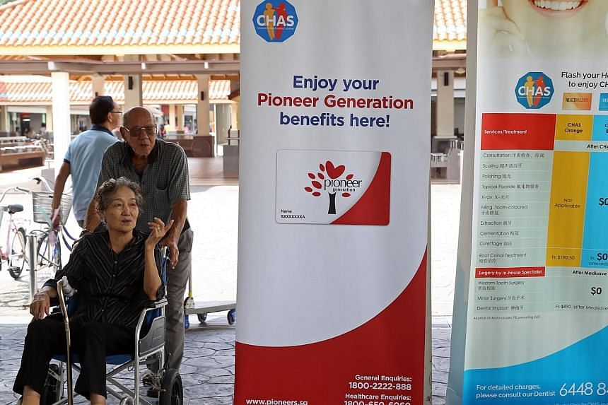 Banners explaining the Community Health Assist Scheme (Chas) at Blk 56, New Upper Changi Road. -- ST PHOTO: SEAH KWANG PENG