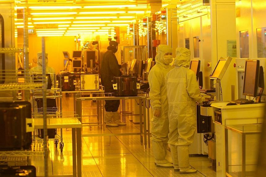 Employees at the production line at Stats ChipPac, a mainboard-listed semiconductor chip packaging and testing firm. Shares in Singapore's Stats ChipPac jumped as much as 17 per cent to $0.775 on Friday, the highest since March 2011, on course f