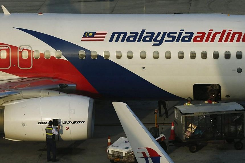 Malaysia Airlines (MAS) is set to slash 6,000 jobsas part of a major revamp after suffering the loss of two Boeing jets this year. -- PHOTO: REUTERS