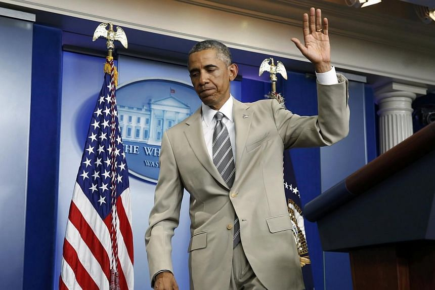 US President Barack Obama departs the White House Press Briefing Room after addressing reporters in Washington on Aug 28, 2014. The light-coloured summer suit donned by Mr Obama, who usually sticks to sombre colours like grey or blue, sparked a storm