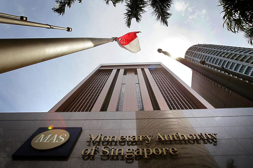 The Monetary Authority of Singapore.Monthly bank loans disbursed by lenders here fell for the first time in nearly five years in July as a dip in business lending dragged the numbers down. -- PHOTO: ST FILE