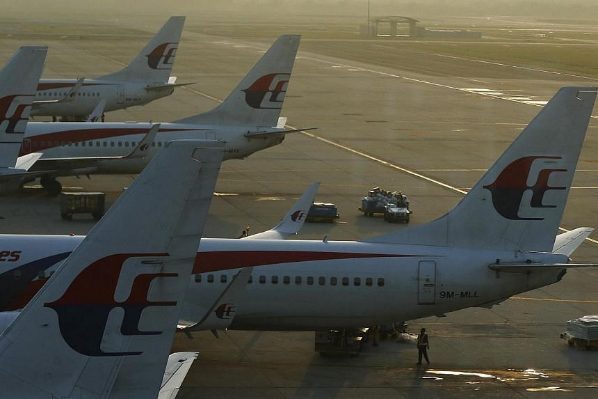 Malaysia Airlines planes on the runway at the Kuala Lumpur International Airport. Trading of MAS shares was suspended on Friday ahead of a material announcement. -- PHOTO: REUTERS