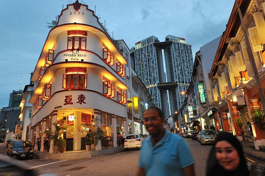Above: At least eight businesses have opened in Keong Saik Road this year, including Potato Head Folk, a group of food, drink and entertainment outlets within a building dated 1939. Left: Brothels occupied at least half of the buildings there about a
