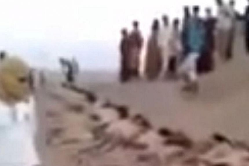 An image grab taken from a video uploaded on social networks on August 28, 2014, shows young men in underwear lying on the ground after being allegedly executed on August 27, 2014 by Islamic State militants at an undisclosed location in Syria's Raqa