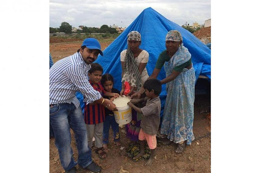 """The famous """"ice bucket"""" challenge is inspiring thousands of Indians to follow suit, but with a twist - they are replacing ice with rice in a bid to help the country's vast population of poor, hungry people. -- PHOTO: RICE BUCKET CHALLENGE/FACEBOOK&nb"""