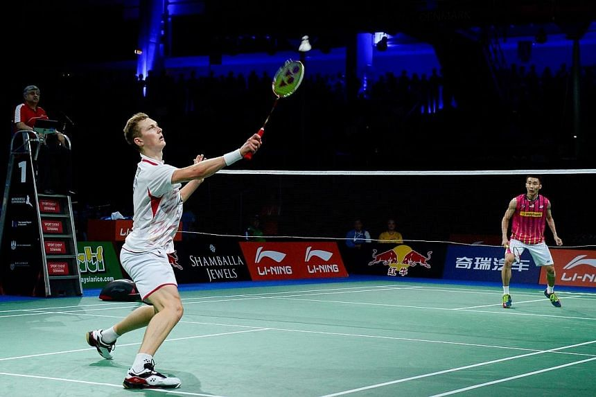 Denmark's Viktor Axelsen (left) competes against Malaysia's Chong Wei Lee during the men's single semi final match at the 2014 BWF Badminton World championships held at the Ballerup Super Arena in Copenhagen on Aug 30, 2014. -- PHOTO: AFP