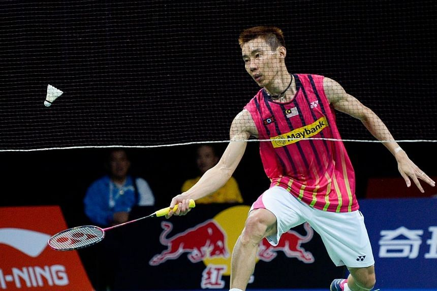 Malaysia's Chong Wei Lee competes against Denmark's Axelsen during the men's single semi final match at the 2014 BWF Badminton World championships held at the Ballerup Super Arena in Copenhagen on Aug 30, 2014. -- PHOTO: AFP