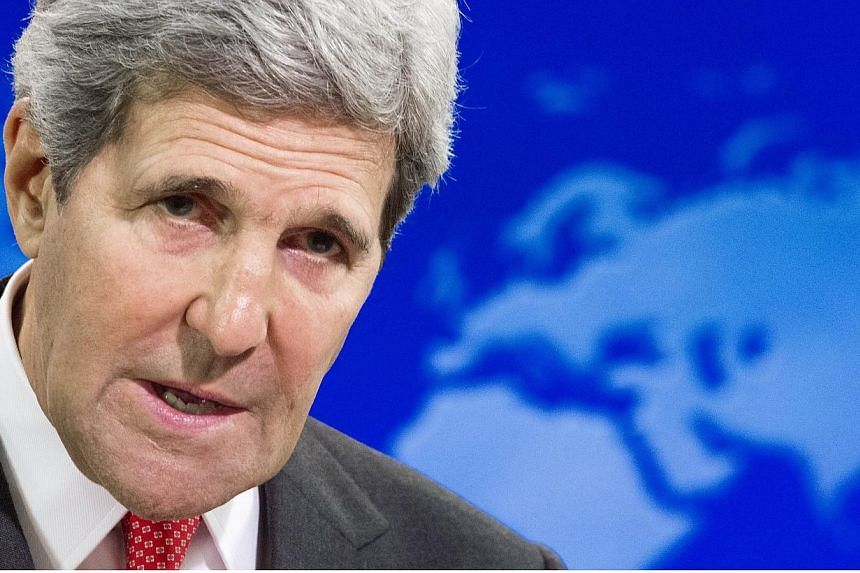 US Secretary of State John Kerry delivers remarks while releasing the 2013 Annual Report on International Religious Freedom at the US State Department in Washington, DC July 28, 2014. Mr Kerry has called for a global coalition to combat Islamic State