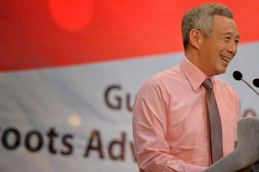 PM Lee Hsien Loong gives his opening address during the Ang Mo Kio GRC and Sengkang West SMS Citizenship Ceremony held on Aug 30, 2014. -- ST PHOTO:MARK CHEONG