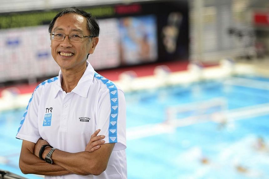 Singapore Swimming Association (SSA) president Lee Kok Choy was coy about the team's medal prospects at next month's Asian Games in South Korea. -- ST PHOTO: DESMOND LIM
