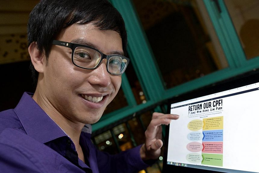 This photograph taken on June 9, 2014 shows Roy Ngerng, a blogger and former patient coordinator at the Communicable Disease Centre, showing his website blog on the computer at his home in Singapore. -- PHOTO: AFP