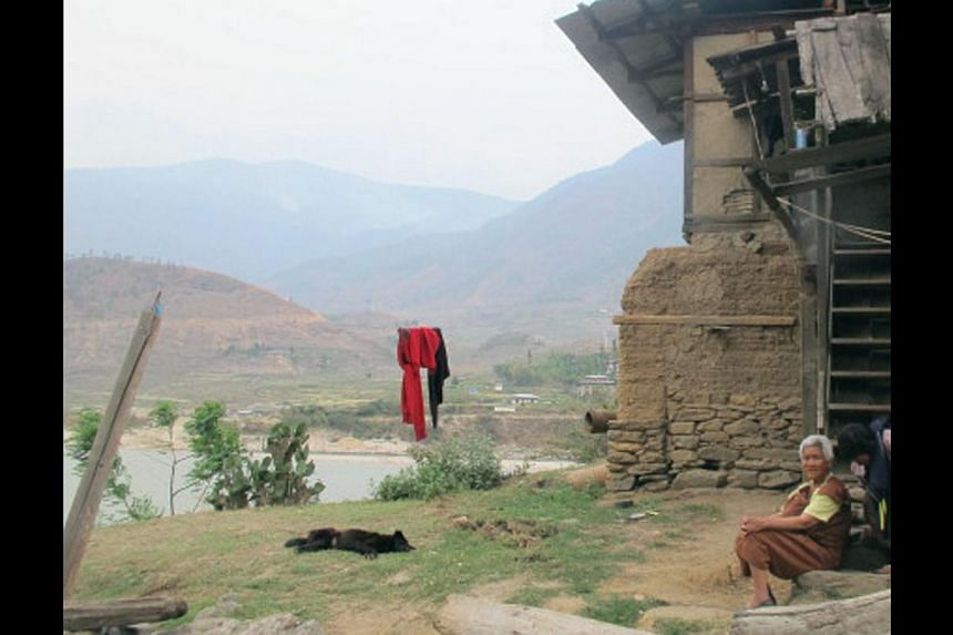 A farmer's house, just a few metres from the Punatsangchu river, falls within what is classified as the red zone, or high-risk area. -- PHOTO: ASIA NEWS NETWORK