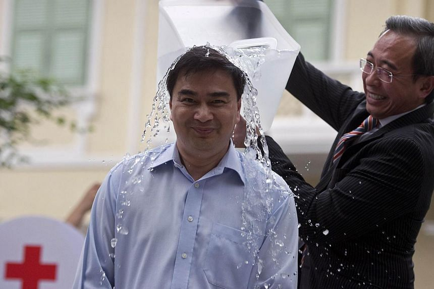 """Former Thai prime minister Abhisit Vejjajiva braves the """"Ice Bucket Challenge"""" to raise awareness of amyotrophic lateral sclerosis - or Lou Gehrig'sdisease - at the Thai Red Cross Society in Bangkok on August 22, 2014.The disease targets the ne"""