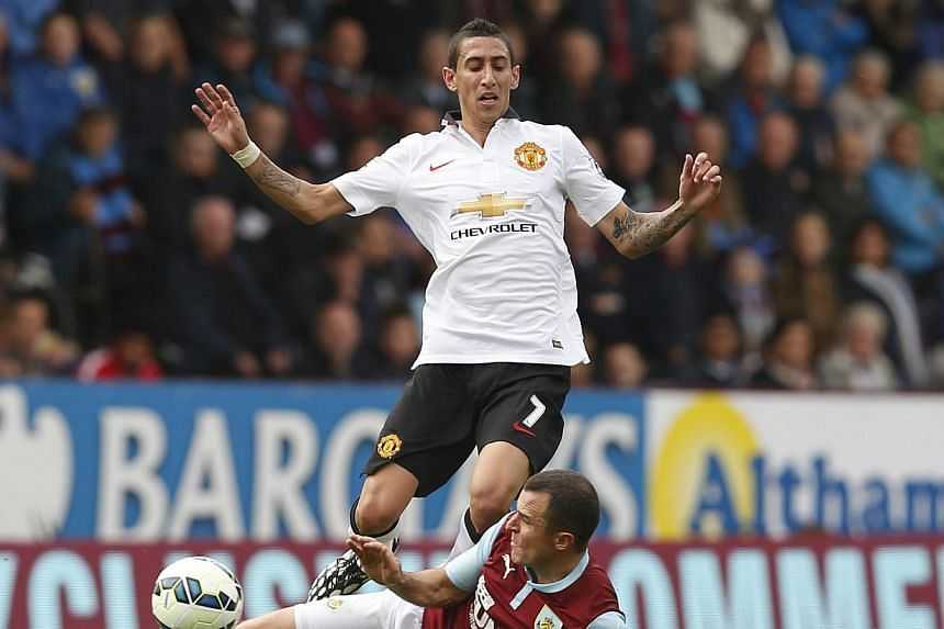 Manchester United's Angel Di Maria (top) is challenged by Burnley's Dean Marney during their English Premier League football match at Turf Moor in Burnley. -- PHOTO: REUTERS