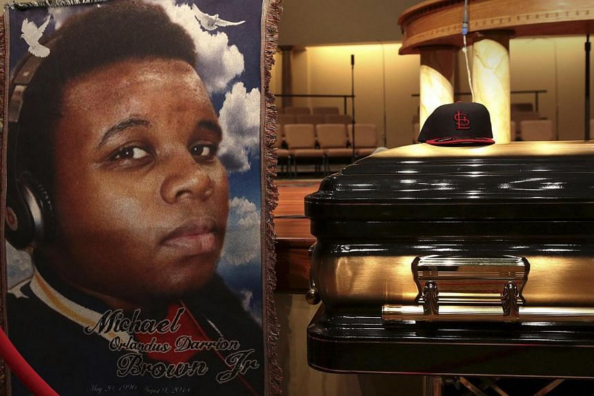 A baseball cap and a portrait of Michael Brown are shown alongside his casket inside Friendly Temple Missionary Baptist Church before the start of his funeral service in St Louis, Missouri on August 25, 2014. Teenager Brown was shot dead by a wh