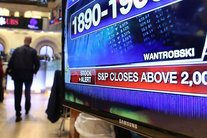 A television monitor displays news on the floor of the New York Stock Exchange on August 26, 2014 in New York City. The S&P 500 pushed back above 2,000 on Friday - the milestone it closed above for the first time on Tuesday - to finish at 2,003.3