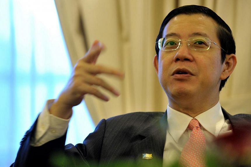 A Molotov cocktail was thrown into the compound of Penang Chief Minister Lim Guan Eng's house on Saturday night, but no one was injured. -- PHOTO: ST FILE