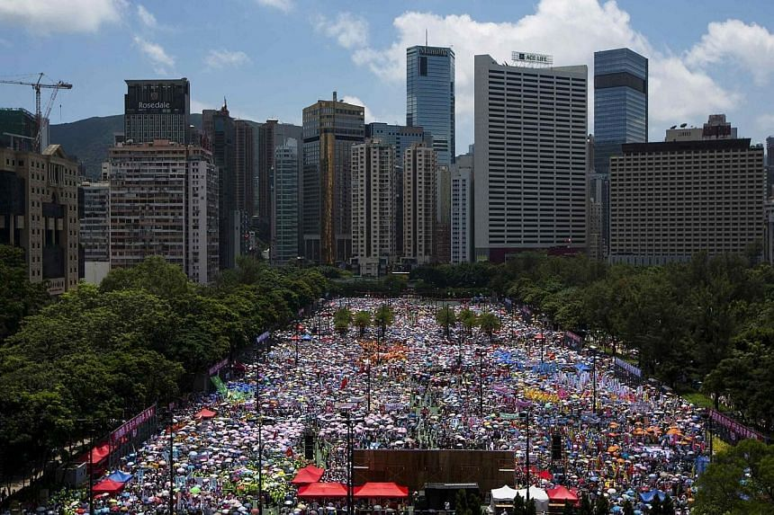 Thousands of pro-Beijing protesters gather to march in the streets against a pro-democracy Occupy Central campaign in Hong Kong on Aug 17, 2014. -- PHOTO: REUTERS