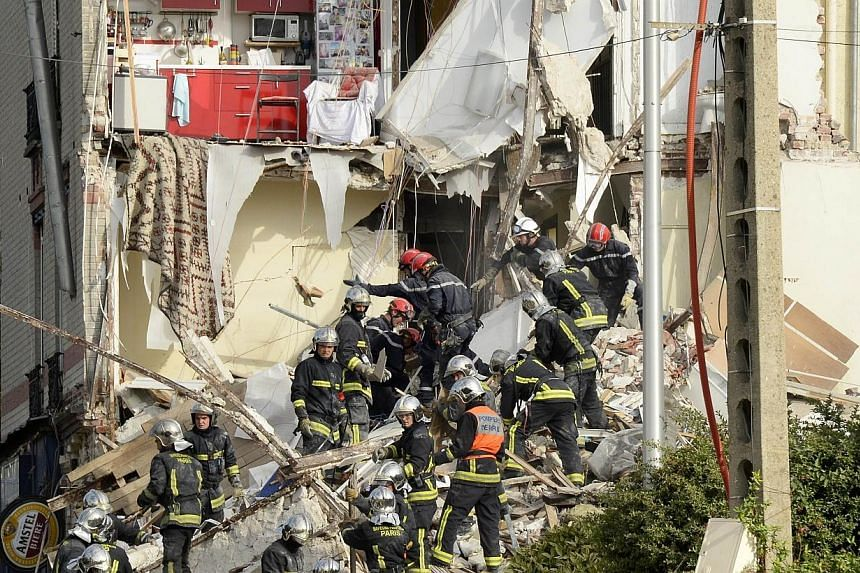 French firefighters search through the rubble of a four-storey residential building that collapsed following a blast in Rosny-sous-Bois in the eastern suburbs of Paris on Aug 31, 2014. -- PHOTO: AFP
