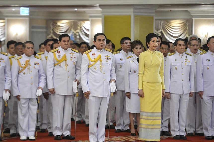 Thailand's newly appointed Prime Minister Prayuth Chan-ocha (centre) stands with his wife Naraporn during the royal endorsement ceremony at the Royal Army headquarters in Bangkok on Aug 25, 2014. Thailand's coup leader and newly appointed premie