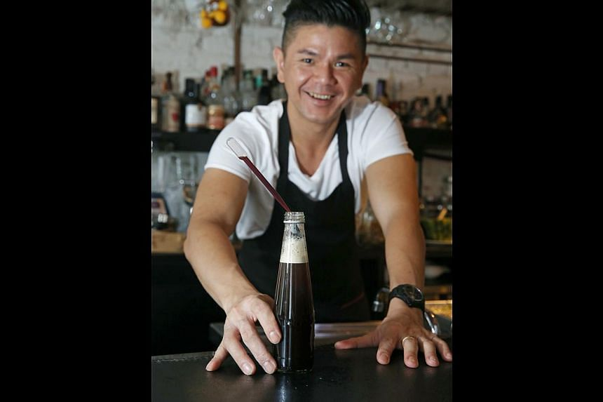 Consumers these days are keen to try new things, says barman Ethan Leslie Leong, with his creation Liang Teh. -- PHOTO: SEAH KWANG PENG
