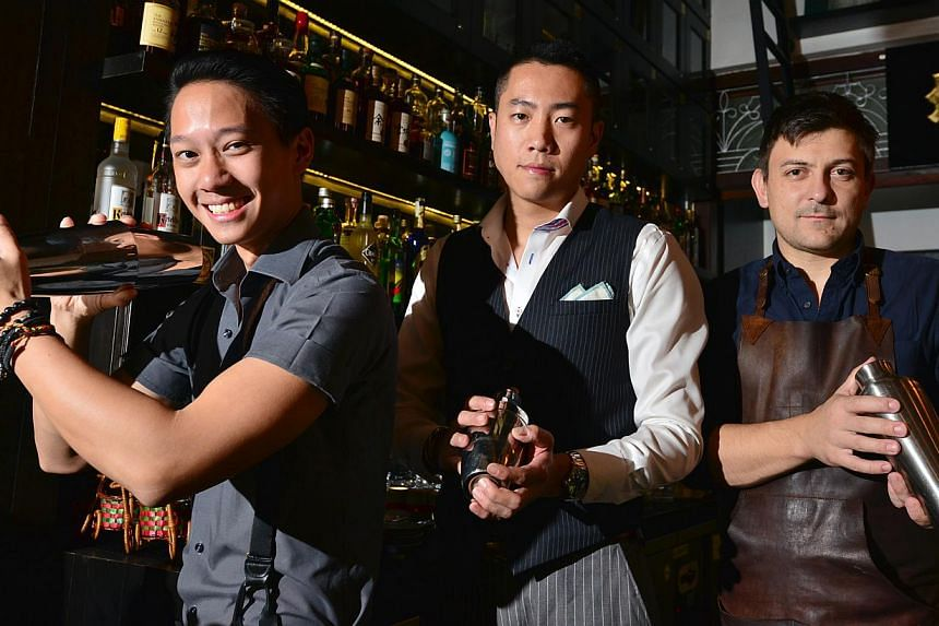 The vibrant bar scene here boasts barmen from around the world, including (from left) Singaporean Peter Chua, Taiwanese Kae Yin and Czech Kamil Foltan. -- PHOTO: DIOS VINCOY JR FOR THE SUNDAY TIMES