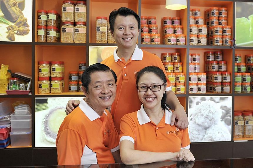 Mr Alan Tan of HarriAnn's Delights (centre, with his father Harry and sister Sharon) is keen to promote his shop's heritage food with Slow Food Singapore.. -- PHOTO: ST FILE