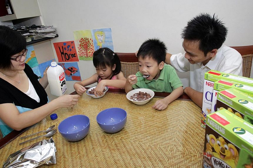 Lavinia (in pink), seven, and Levi, five, having cereal during breakfast with their parents Leonny Atmadja (left), 35, and Wilson Hidajat, 36. Whole grains, having about five times more antioxidants than most greens, are shaping up to be the latest w