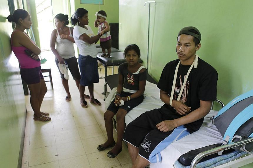A rescued miner (right) waits to be discharged from hospital to go back home, in Bonanza, northeastern Nicaragua, on August 30, 2014. Rescuers in Nicaragua on Friday rescued 20 miners who had been trapped deep underground for nearly two days after a