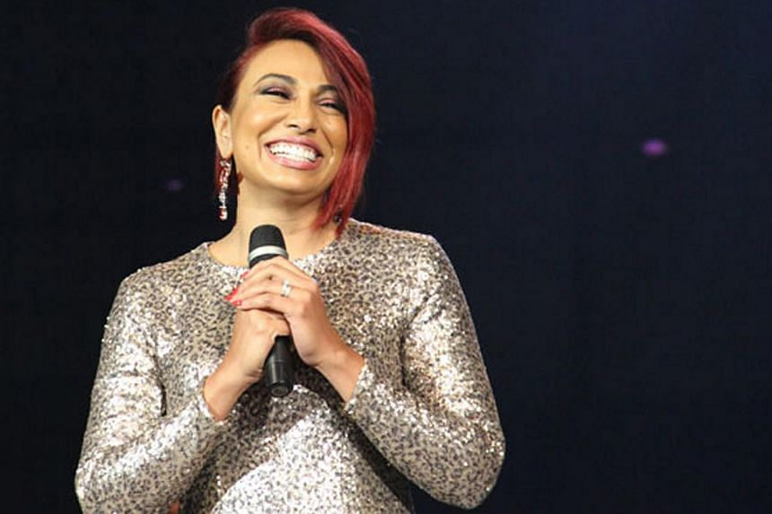 Malaysian singer Ning Baizura is certainly a trouper. Despite nursing a nasty flu, she soldiered on to deliver her first major solo gig in Singapore. -- PHOTO: ESPLANADE THEATRES ON THE BAY