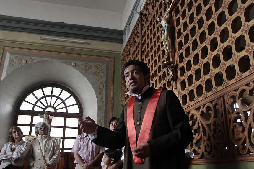 A guide in 19th century attire gives explanations to visitors at the Mothers of Augustine conventin Quito, on August 29, 2014. To commemorate the 150th anniversary of the arrival of the Mothers of Augustine, or Madres Agustinas,in Ecuador