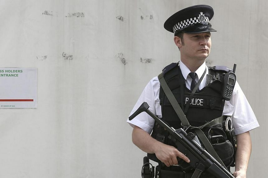 An armed police officer is seen on duty outside the Houses of Parliament in central London on Aug 30, 2014.British Prime Minister David Cameron was to outline tougher measures against jihadist suspects on Monday after Britain raised its securit